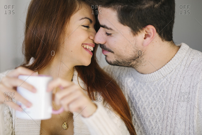 Young beautiful couple having good time at home