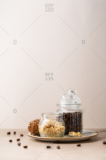 Pine nuts against beige wall
