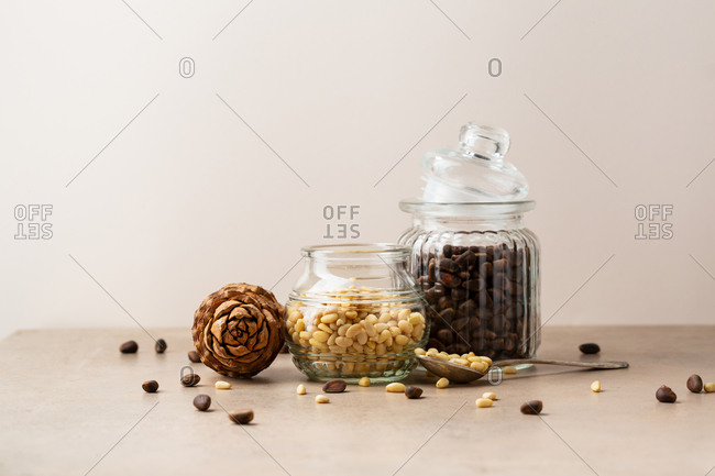 Pine nuts on table against beige wall
