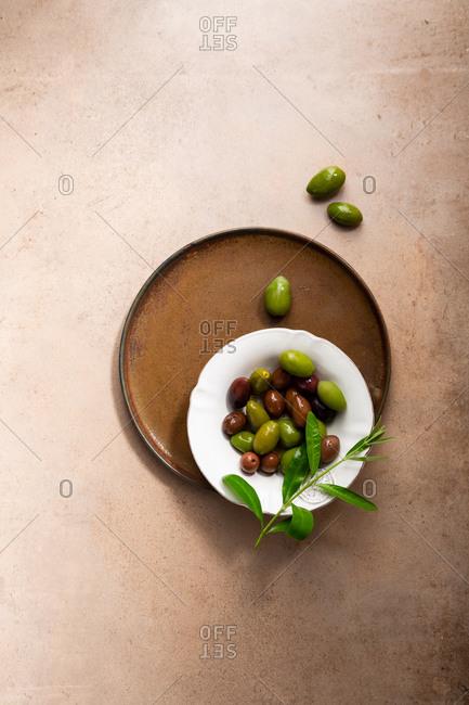 Variety of pickled olives on platter