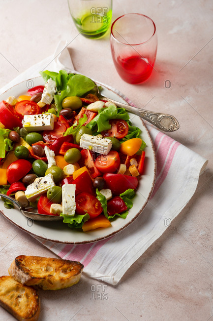 Close up of Mediterranean salad with cheese and olive