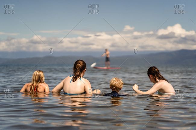Family swimming in the ocean