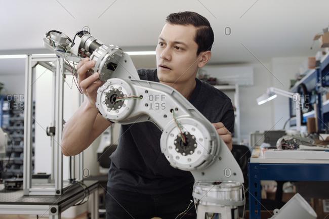Engineer building a robotic arm
