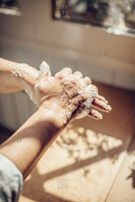 Close-up of a woman's hands pouring disinfectant soap on her hands