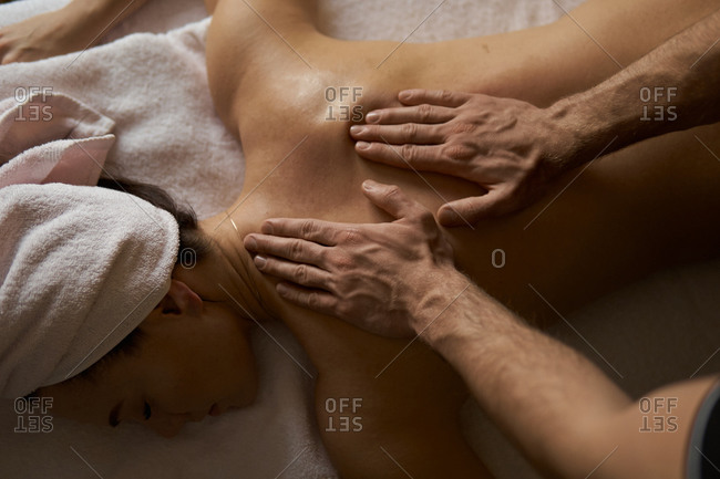 Woman laying on massage table receiving massage