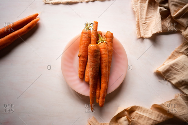 Layflat of a bunch of raw carrots.