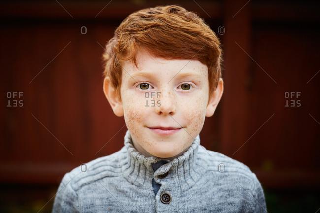 Portrait of smiling boy in yard