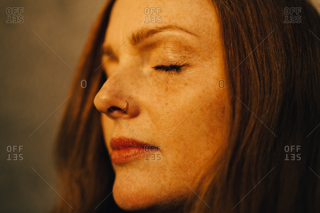 Close-up of woman with eyes closed