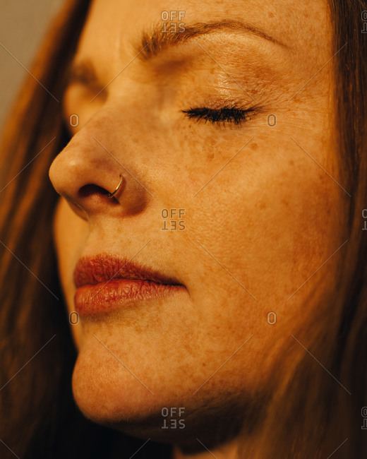 Close-up of woman with eyes closed in sunlight