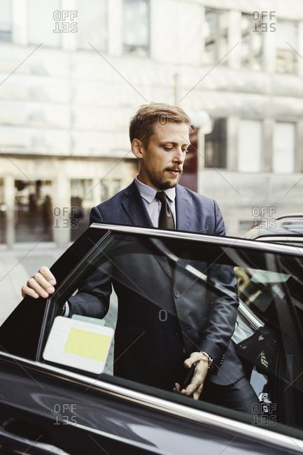 Male entrepreneur entering in car