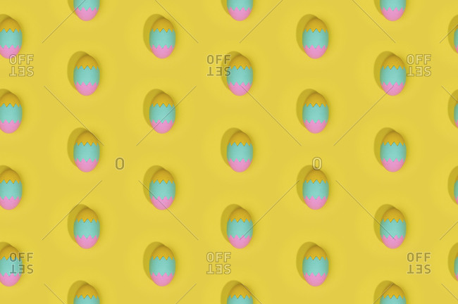 Seamless Easter pattern with colored decorated eggs arranged in rows on yellow background
