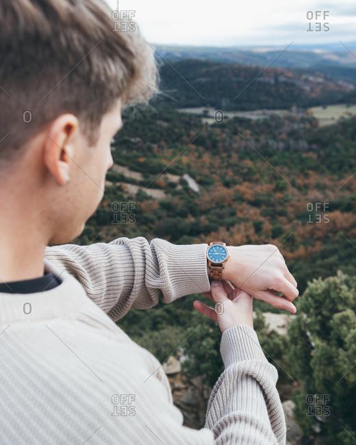 Traveler checking time on wristwatch