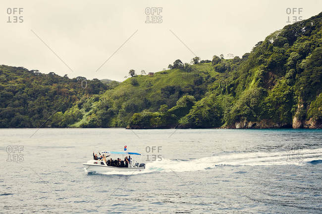 Cocos Island, Costa Rica - October 3, 2018: Scuba divers on boat in the Pacific Ocean