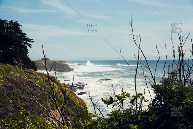 Brid's eye view over waves crashing in the Pacific Ocean, Santa Cruz, California