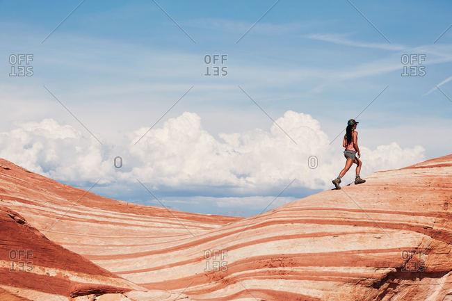 Woman hiking and exploring around Valley of Fire State Park, Nevada