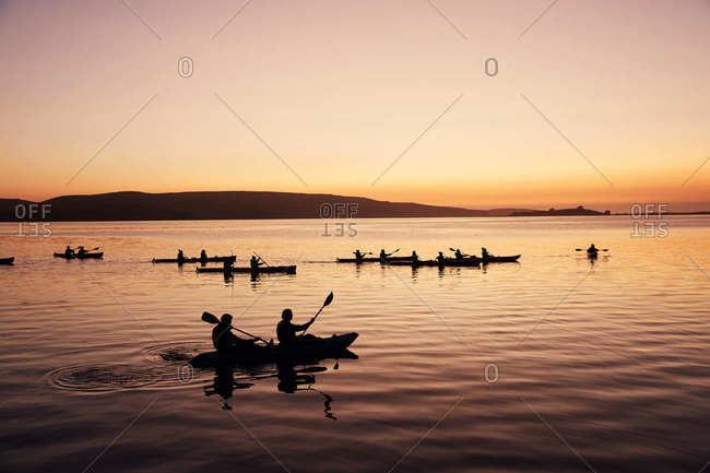 Kayakers at Tomales Bay at sunset in California