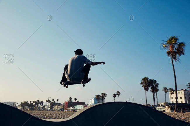 Back view of skateboarder at Venice Beach