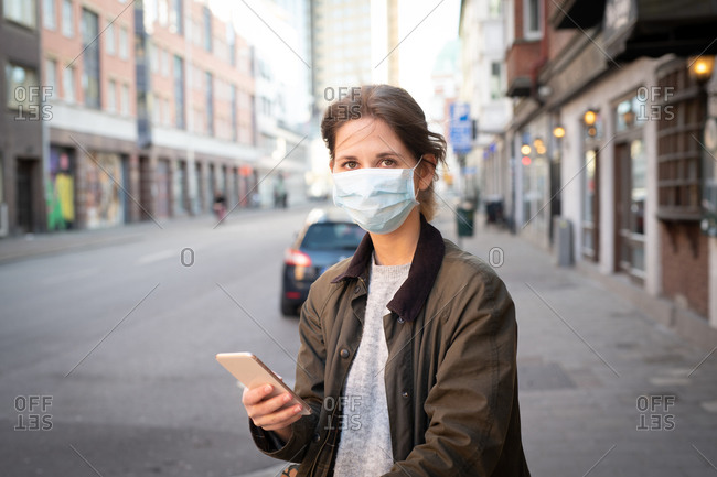 Woman on city street wearing a face mask outdoors