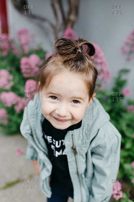 Adorable little girl with silly hair do for crazy hair day