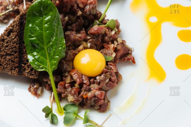 Haute cuisine tartar on white plate