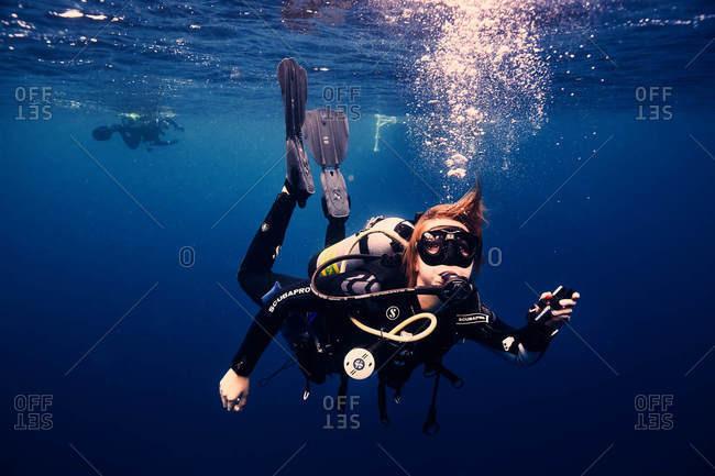 Cocos Island, Costa Rica - October 6. 2018: Underwater shot of a scuba diver in the ocean