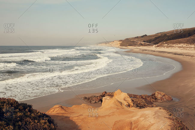 Waves rolling into beach in San Mateo County, California
