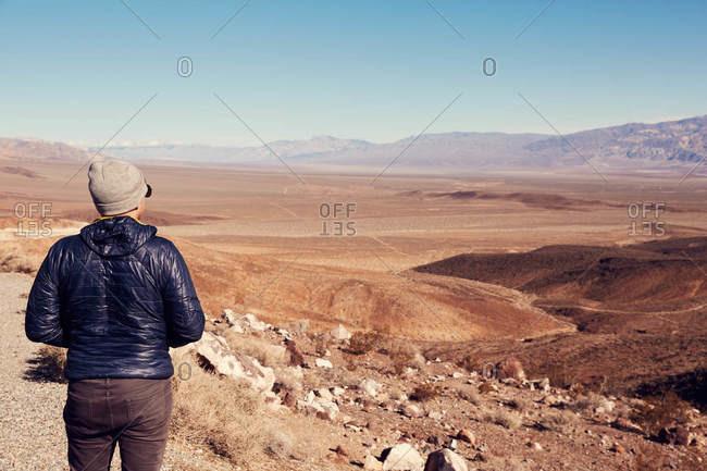 Hiker overlooking Death Valley in California