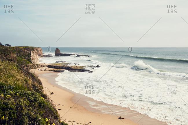 Crashing in the Pacific Ocean at a beach in Santa Cruz, California