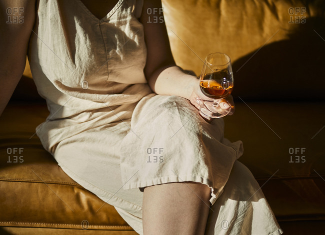 Woman holding a whisky drink
