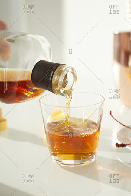 Making whiskey cocktails at a party