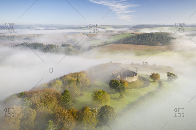 Aerial view by drone of Restormel Castle on a misty autumn morning, Lostwithiel, Cornwall, England, United Kingdom, Europe