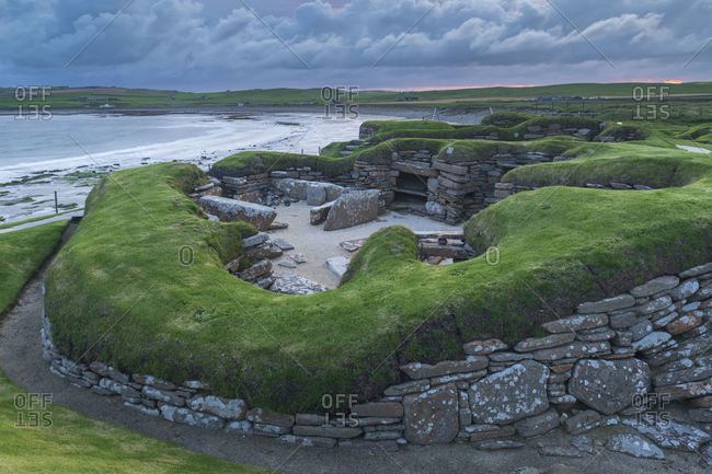 September 5, 2019: Stormy sky over Skara Brae, UNESCO World Heritage Site, a Neolithic village on the Mainland of Orkney, Scotland, United Kingdom, Europe