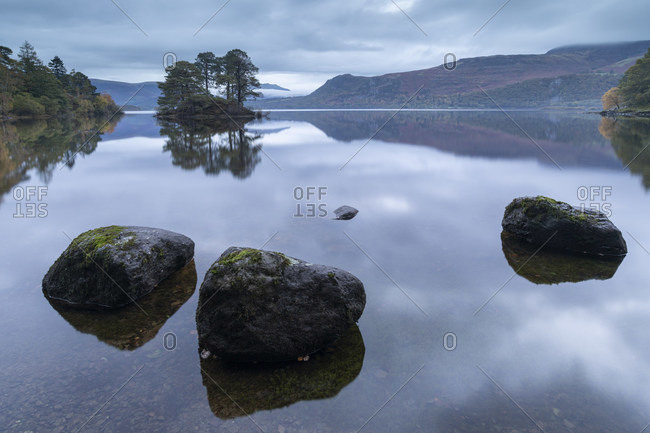 Reflective Derwent Water at dawn in the Lake District National Park, UNESCO World Heritage Site, Cumbria, England, United Kingdom, Europe