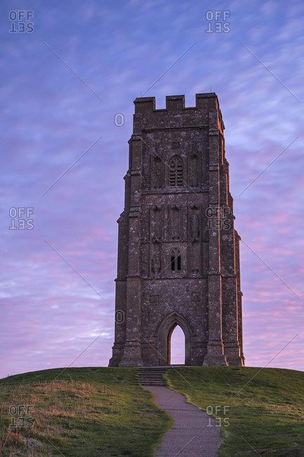 St. Michael's Tower on Glastonbury Tor at dawn in winter, Glastonbury, Somerset, England, United Kingdom, Europe