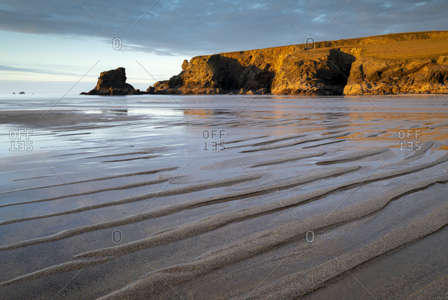 Low tide on a deserted Porthcothan Beach, Cornwall, England, United Kingdom, Europe