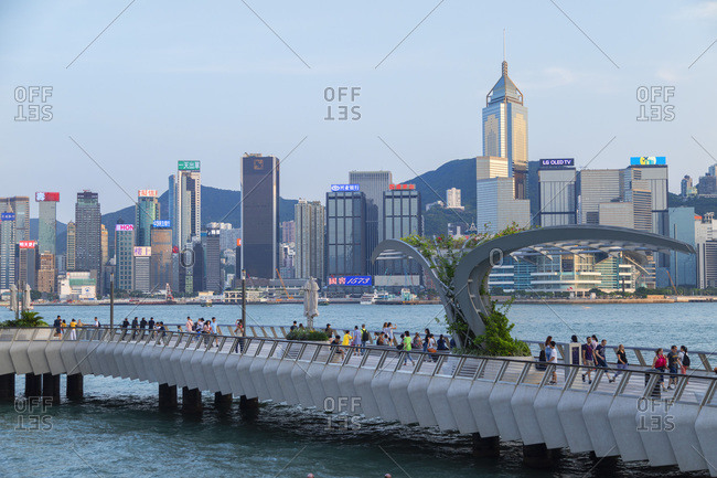 August 7, 2019: Tsim Sha Tsui promenade and Hong Kong Island skyline, Kowloon, Hong Kong, China, Asia