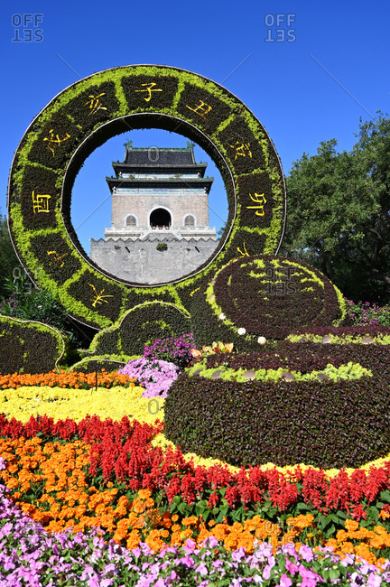 June 10, 2018: Elaborate floral decorations celebrating 70 years of China framing the Bell Tower, built in 1272, Beijing, China, Asia