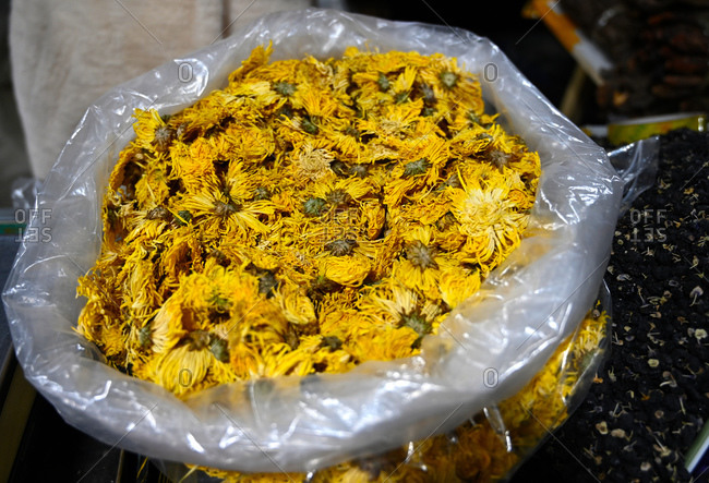 Partially dried chrysanthemum flower heads for tea, for sale in Shazhou market, Dunhuang, China, Asia