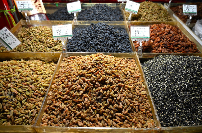 October 18, 2019: Locally grown grapes dried into raisins and sultanas, for sale in Shazhou market, Dunhuang, Gansu, China, Asia