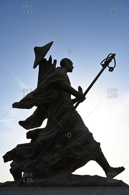 October 21, 2019: Statue of 7th century monk, Xuanzang, carrying Buddhist sutras, Gaochang ruins, Xinjiang, China, Asia