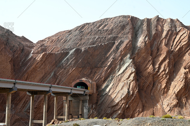 Recent Silk Road construction through solid rock in the Taklamakan Desert near Kuche, Xinjiang, China, Asia