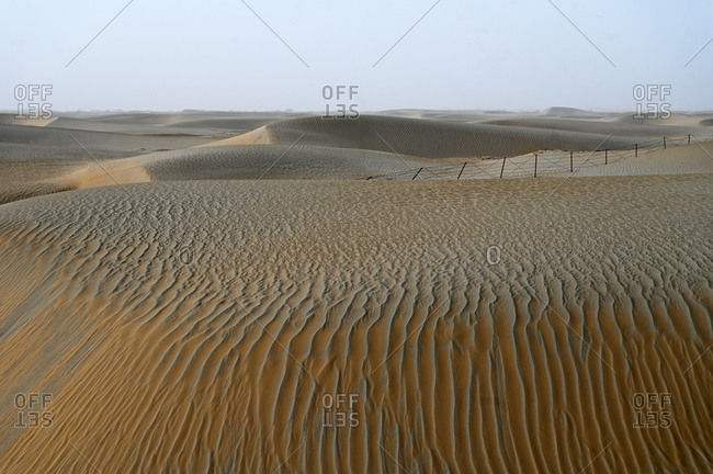Undulating wind blown sands in the Taklamakan desert, Hotan, Xinjiang Uyghur region, China, Asia