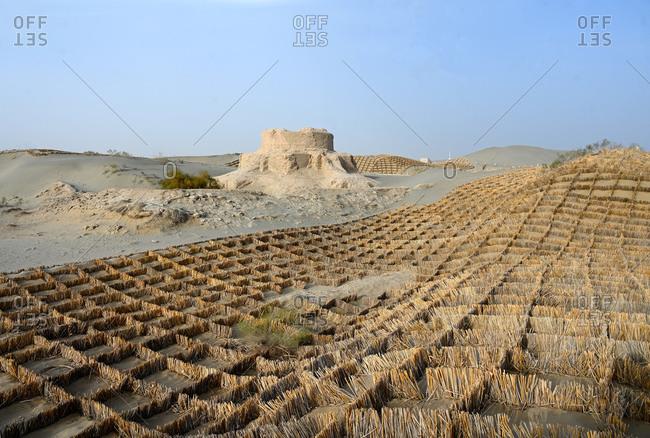 Straw sand control barriers around the 4th century Rawak Buddhist stupa, Hotan, Xinjiang, China, Asia