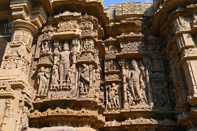 Wall of ornately carved Modhera Sun temple, built in 1026 by Bhima of Chaulukya dynasty, Modhera, Mehsana, Gujarat, India, Asia