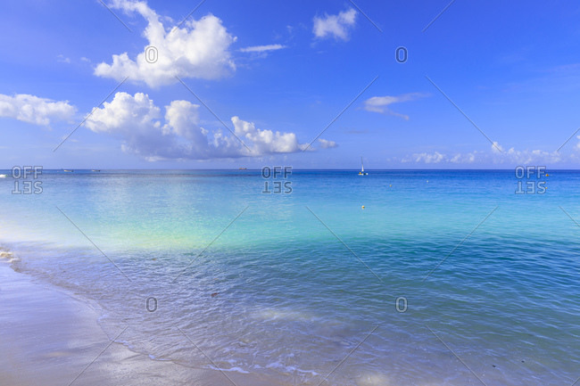 Paynes Bay, small boats off fine pale pink sand beach, turquoise sea, beautiful West Coast, Barbados, Windward Islands