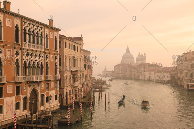 February 11, 2019: Beautiful Grand Canal, winter fog, morning golden light, Santa Maria della Salute, Venice, UNESCO World Heritage Site, Veneto, Italy, Europe