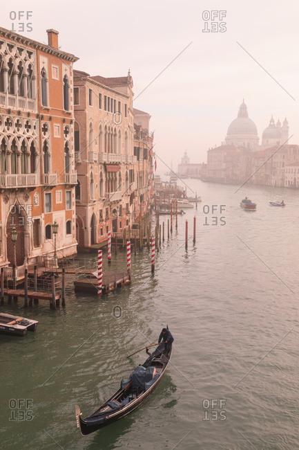 February 11, 2019: Beautiful Grand Canal, winter fog, gondola, Basilica Santa Maria della Salute, Venice, UNESCO World Heritage Site, Veneto, Italy, Europe