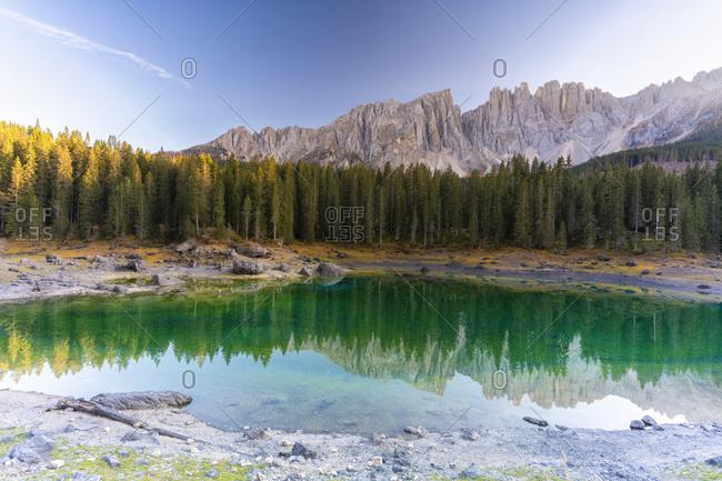 Sunset over Carezza Lake and Latemar mountain range, Dolomites, South Tyrol, Italy, Europe