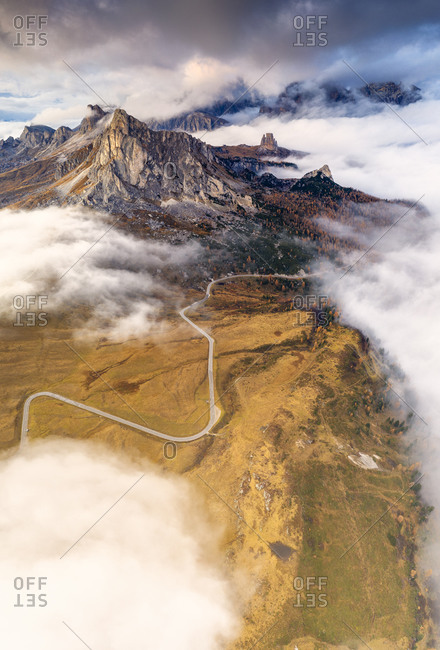 Aerial view by drone of Giau Pass, Ra Gusela and Cinque Torri in the mist of autumn, Dolomites, Belluno province, Veneto, Italy, Europe