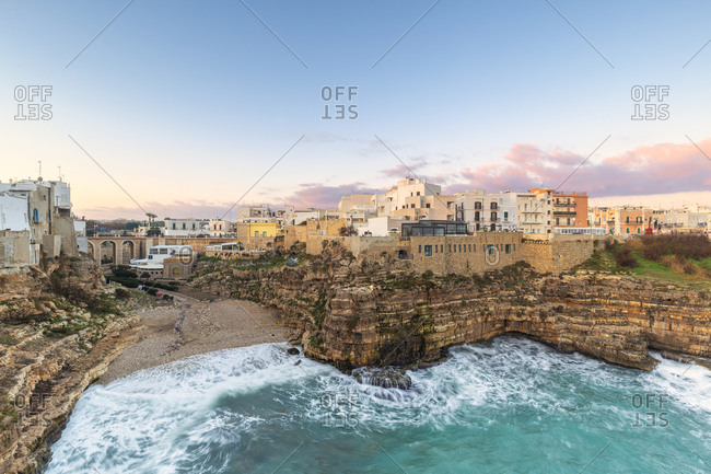 January 2, 2020: Sunrise with view on the beach of Lama Monachile from above, Polignano a Mare, Apulia, Italy, Europe